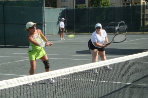 playing tennis in Delray Beach, Fla