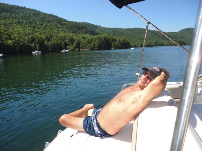 my hubby relaxing on Red Rock Bay