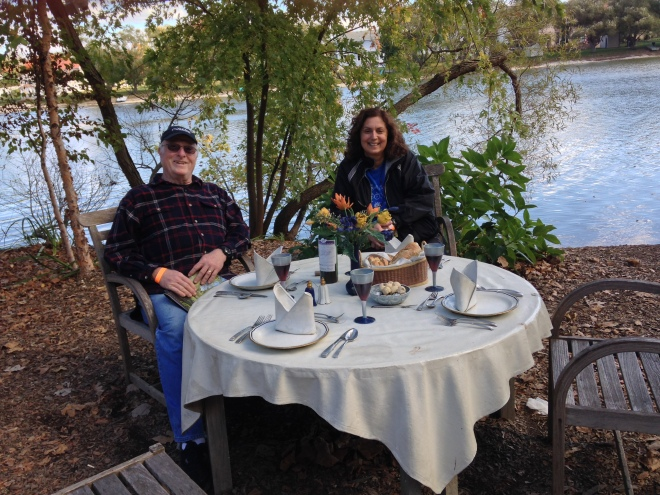 my friends Andrea and her husband Steve at a lakeside table